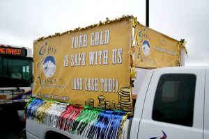 """Your Gold is Safe with Us"" on a truck float."