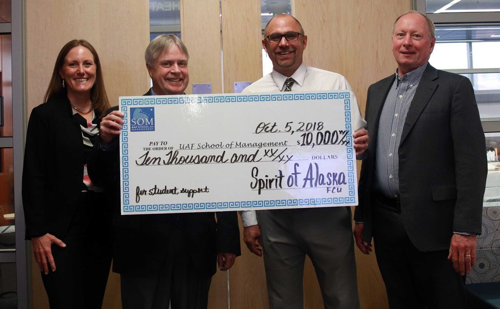 Anthony Rizk presenting check for $10,000 to UAF School of Management on October 5th, 2018